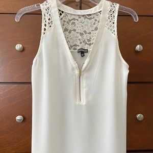 Express ivory tank blouse with cutout detail.